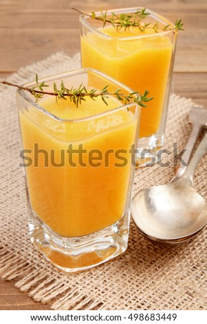 homemade pumpkin soup with thyme in a shot glass