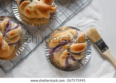 Homemade purple yam bread fresh from oven - stock photo