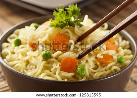 Homemade Quick Ramen Noodles with carrots and peas - stock photo