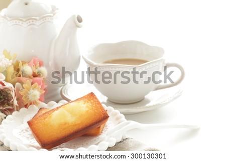 Homemade rectangle cake and milk tea - stock photo