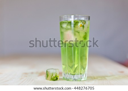 homemade refreshing summer cocktails with ice and mint on wooden cutting Board