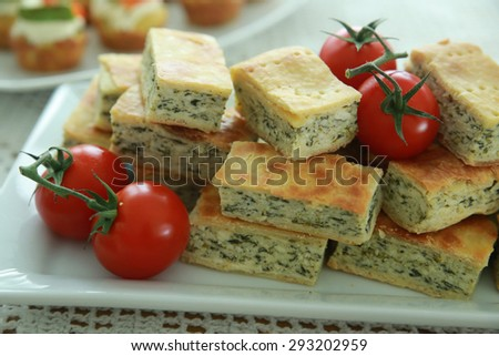 Homemade Ricotta cheese and spinach pie slices on white plate - stock photo