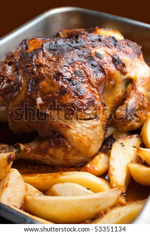 homemade roasted chicken with potatoes - stock photo