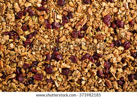Homemade roasted granola on baking sheet breakfast food background  - stock photo