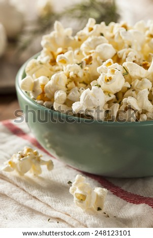 Homemade Rosemary Herb and Cheese Popcorn in a Bowl - stock photo