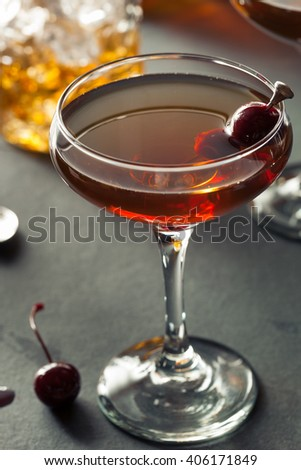 Homemade Rye Bourbon Manhattan with a Cherry Garnish - stock photo