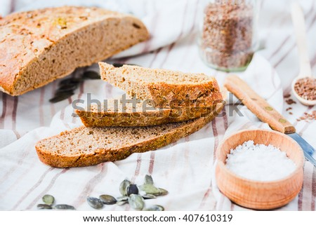 homemade rye bread unleavened with flax seed and pumpkin slices, healthy organic food - stock photo