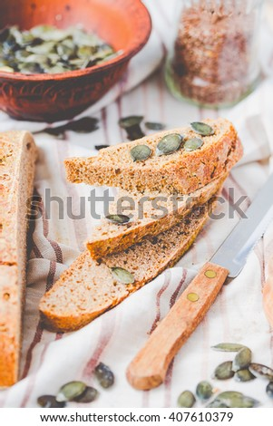 homemade rye bread unleavened with flax seed and pumpkin, slices, healthy organic food, selective focus - stock photo