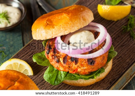 Homemade Salmon Burger with Tartar Sauce and Onion - stock photo