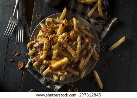 Homemade Salty Cheese French Fries with Bacon - stock photo