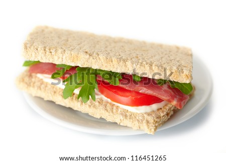 Homemade sandwich with bacon and tomato on white background