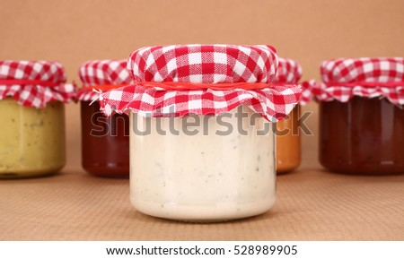 Homemade sauces in jars