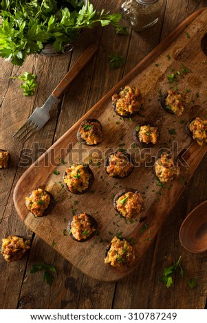Homemade Sausage Stuffed Mushrooms with Cheese and Parsley - stock photo