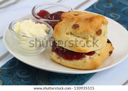 Homemade scone with jam and clotted cream - stock photo