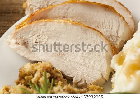 Homemade Sliced Turkey Breast for Thanksgiving Dinner - stock photo