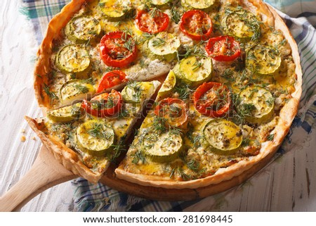 Homemade sliced vegetable quiche with cheese tomatoes and zucchini closeup. horizontal  - stock photo