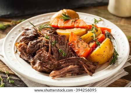 Homemade Slow Cooker Pot Roast with Carrots and Potatoes - stock photo