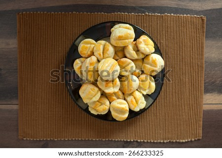 Homemade small bread like snacks with cheese - stock photo
