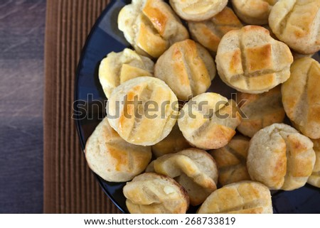 Homemade small salty biscuits with cheese - stock photo