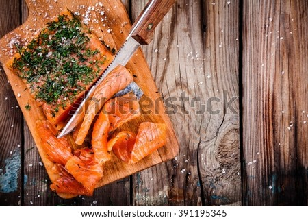 homemade smoked salmon with dill on a wooden table - stock photo