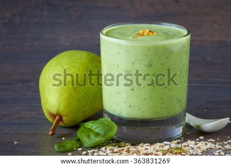 Homemade smoothie made from oats milk, pear, spinach and raw seed - stock photo