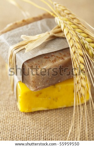 homemade soap bars with wheat spikelets, shallow DOF, super macro