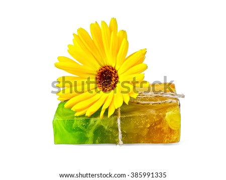 Homemade soap, tied with twine and a yellow calendula isolated on white background - stock photo