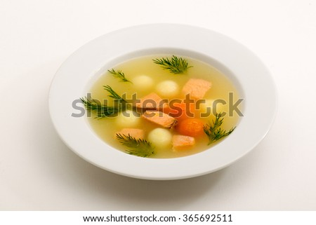 Homemade soup in a white bowl with an antique soup on a light background - stock photo