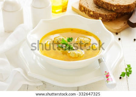 Homemade soup with chicken meatballs. - stock photo