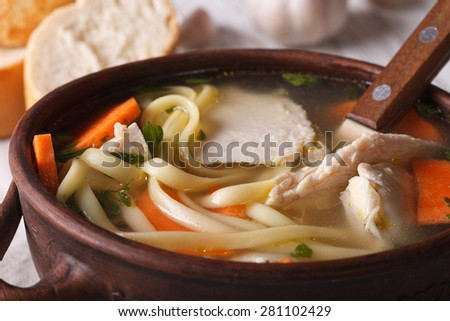 Homemade soup with noodles, chicken and vegetables close-up. horizontal - stock photo