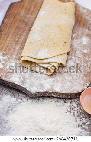 Homemade spaghetti, pasta or noodles on wooden table. Preparation  - stock photo