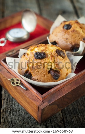 Homemade sponge cake with dried cranberries in the wooden box.Selective focus on the sponge cake