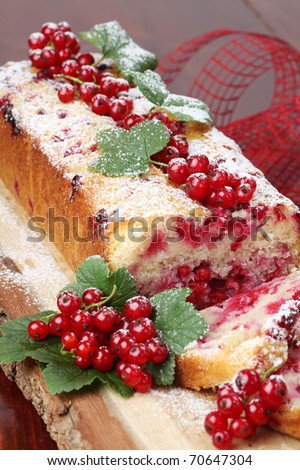 Homemade sponge cake with fresh organic red currants and sugar icing - stock photo