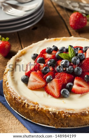 Homemade Strawberry and Blueberry Cheesecake for dessert - stock photo