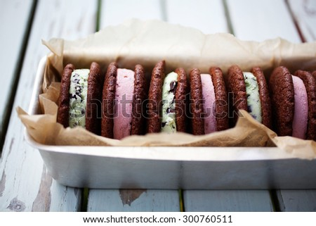 Homemade strawberry and mint ice cream sandwiches - stock photo