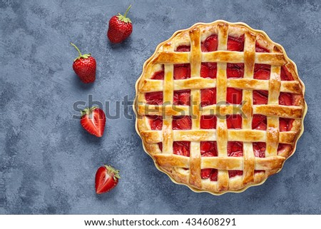 Homemade strawberry pie tart cake sweet baked pastry food on blue table background - stock photo