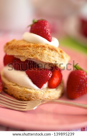 Homemade strawberry shortcake with whipped cream, selective focus, vertical