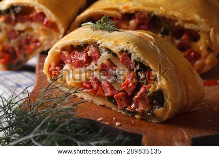 homemade strudel with ham, cheese and fresh vegetables macro horizontal
