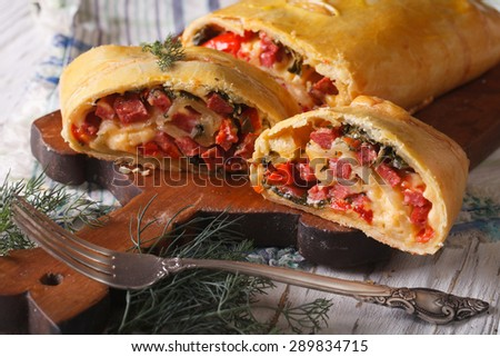 homemade strudel with ham, cheese and vegetables closeup. horizontal