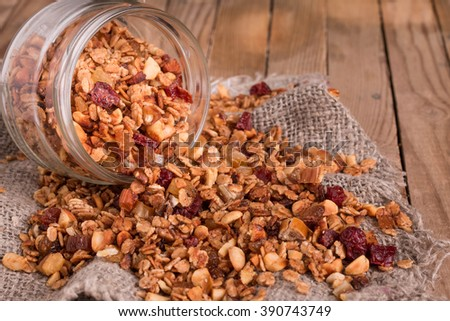 Homemade Sugar Free Granola. Made with healthy nuts, seeds, oats and coconut oil. Naturally sweetened with apple sauce and raisins. No refined sugar added. Selective focus.   - stock photo