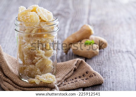 Homemade sugared candied ginger in a glass jar - stock photo