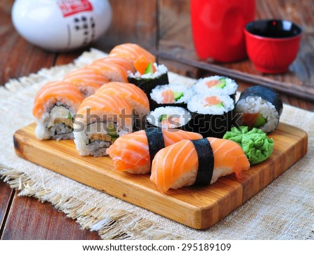 homemade sushi with salmon, cream cheese Philadelphia, Japanese omelette, cucumber and wasabi. selective focus - stock photo