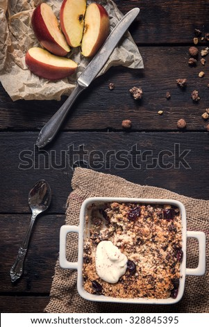 Homemade sweet apple crumble cake from above on dark wooden background - stock photo
