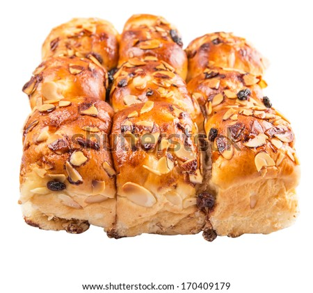 Homemade sweet bun with almond and raisins on a white background - stock photo