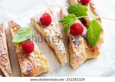 Homemade sweet roll with raspberries and mint - stock photo