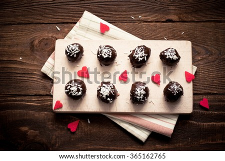 Homemade sweets made from dates, nuts and cookies covered with chocolate and coconut sleep