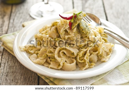 Homemade tagliatelle with glass of wine - stock photo