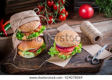 Homemade takeaway hamburger with fresh vegetables - stock photo