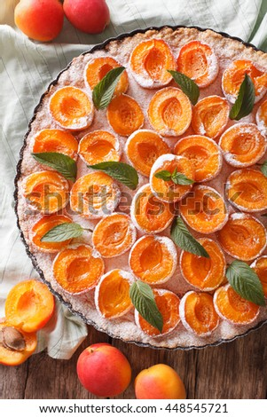 Homemade Tart with fresh apricot macro in baking dish. vertical view from above - stock photo