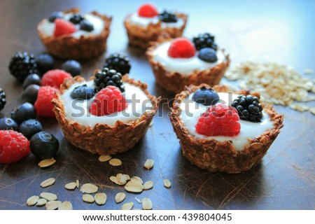 Homemade tarts with oat cereals and fruits - stock photo